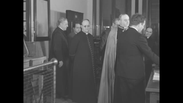 priests and church officials arrive at vatican radio station / radio station interiors / italian language spoken / morse code being typed / radio... - state of the vatican city stock videos & royalty-free footage