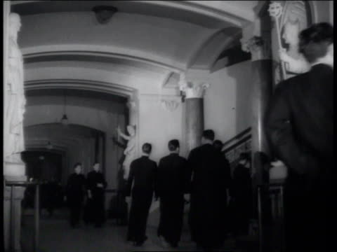 1941 la priests and seminary students walking down the hall at st. joseph's seminary / fordham university, new york city, new york  - priest stock videos & royalty-free footage