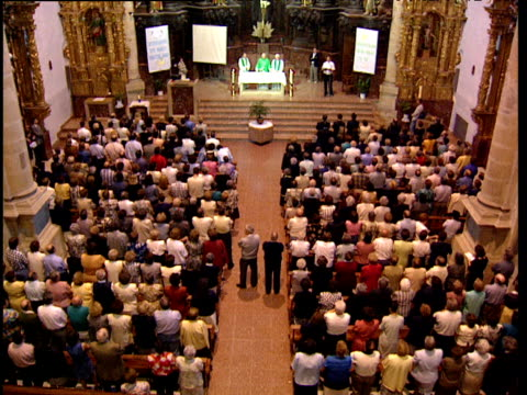 stockvideo's en b-roll-footage met priests and worshippers sing during mass in catholic church basque country spain - gelovige