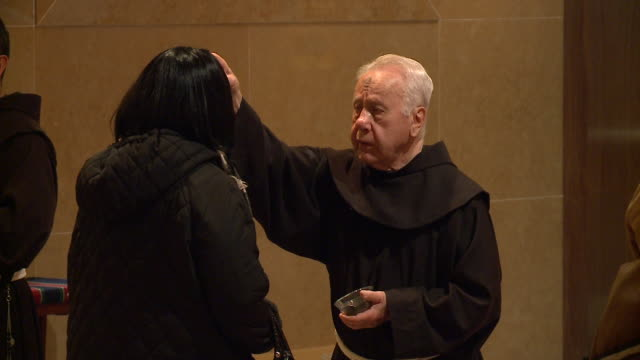 WGN Priests Apply Ashes on Foreheads on Ash Wednesday at St Peter's in the Loop in Chicago on February 14 2018