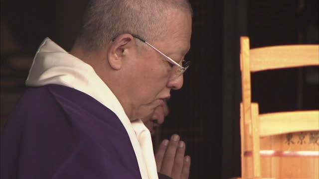 cu priests chanting, tokyo, japan - chanting stock videos and b-roll footage