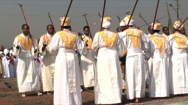 ms priests performing traditional dancing during procession of timka, ethiopian orthodox celebration of epiphany, addis ababa, ethiopia - äthiopien stock-videos und b-roll-filmmaterial