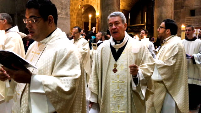 priests take part in a procession to celebrate easter sunday at the church of the holy sepulcher in the old city on april 1 2018 in jerusalem israel... - easter stock videos & royalty-free footage