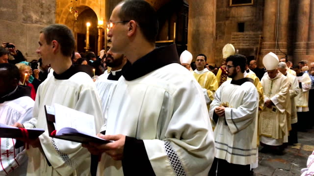 priests take part in a procession to celebrate easter sunday at the church of the holy sepulcher in the old city on april 1, 2018 in jerusalem,... - easter stock videos & royalty-free footage