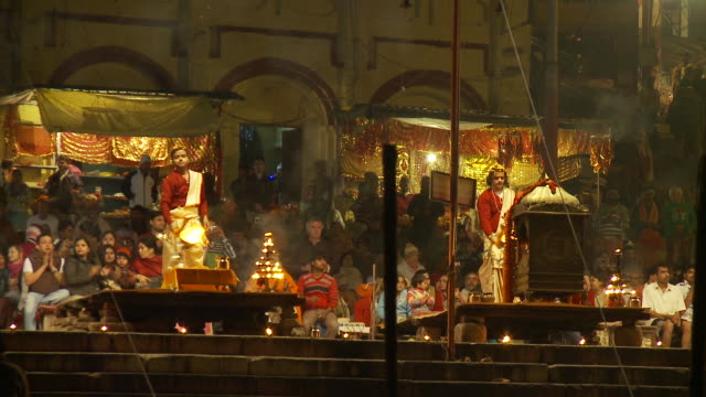 Priests wave flaming lamps during a puja ceremony at the Dashashwamedh Ghat in Varanasi, India.