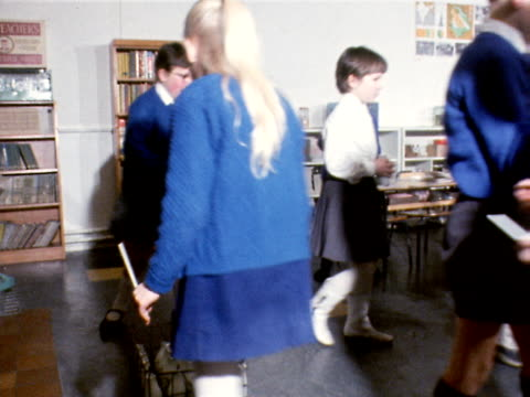 primary school children collect milk bottle from a crate in their classroom 1969 - milk bottle stock videos & royalty-free footage