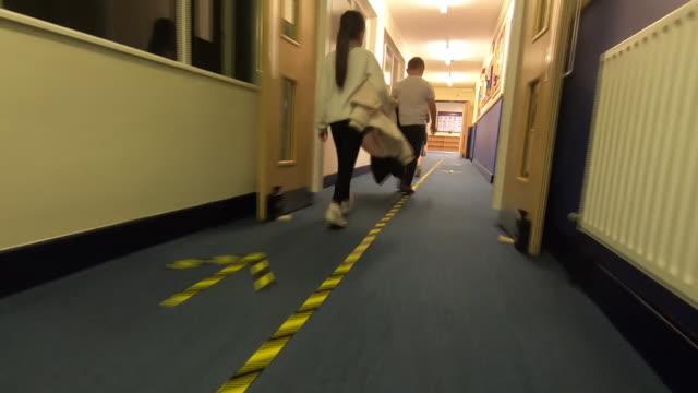 primary school children walking through a school corridor with coronavirus social distancing markings on the floor - pattern stock videos & royalty-free footage