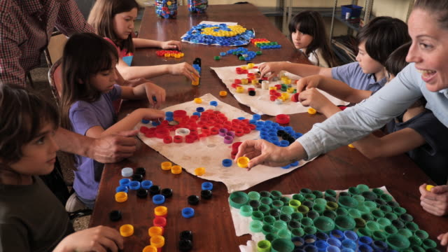 primary school - education in latin america, developing kids' creative skills - bottle cap stock videos & royalty-free footage