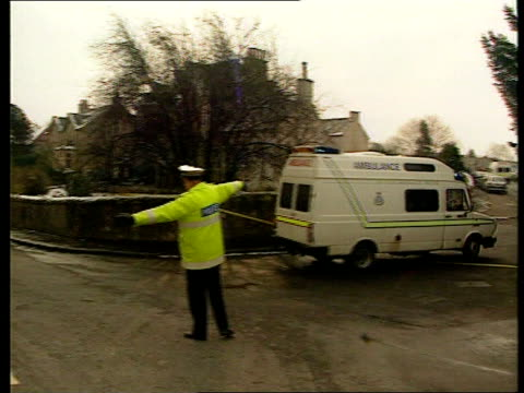 primary school shooting at dunblane; scotland: dunblane: ext side traffic policeman outside school directing man cms sign 'dunblane primary school'... - ダンブレーン点の映像素材/bロール