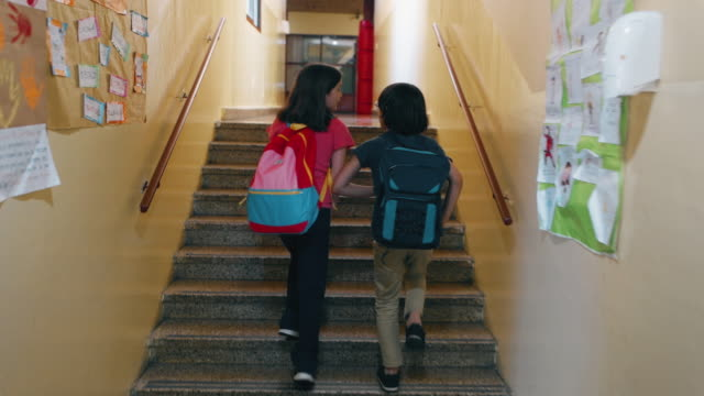 primary school students walking to class - side by side stock videos & royalty-free footage