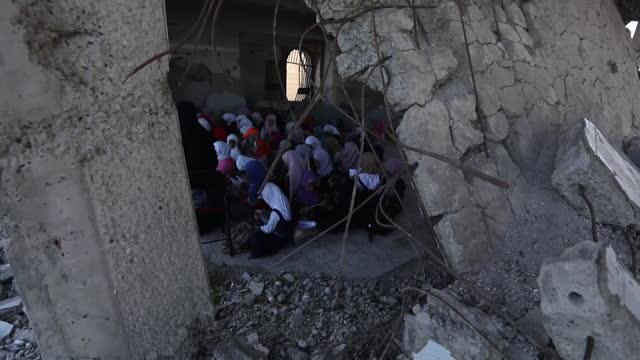 primary schoolchildren in classroom in damaged school building in war torn taiz, yemen - yemen stock videos & royalty-free footage