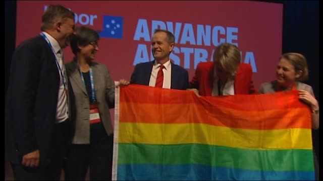 prime minister abbott is offering his own mp's a compromise on same sex marriage after labor promised at the weekend to bring on a vote on the issue... - ausrutscher stock-videos und b-roll-filmmaterial