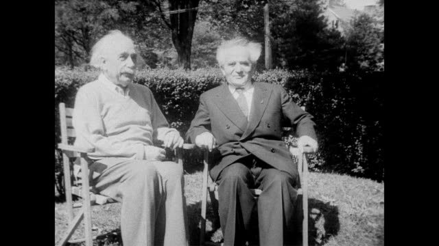 / Prime Minister Ben Gurion of Israel arrives in Princeton / Gurion shakes hands with Albert Einstein / both men sit down outside enjoying the...