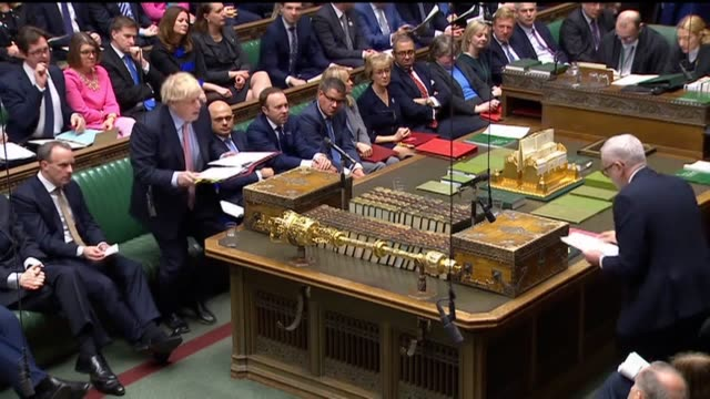 prime minister boris johnson and leader of the opposition jeremy corbyn clash over president trump's plan for peace in the middle east speaking at... - prime minister's questions stock videos & royalty-free footage