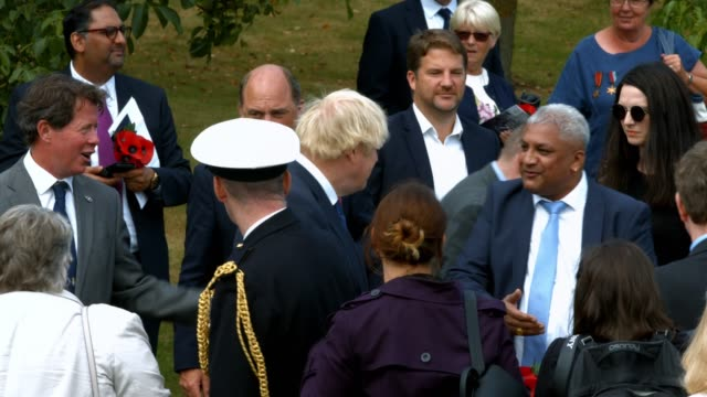prime minister boris johnson arrives to attend the national service of remembrance marking the 75th anniversary of vj day at the national memorial... - national memorial arboretum stock videos & royalty-free footage