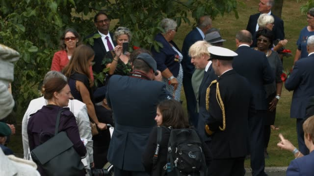 prime minister boris johnson arrives to attend the national service of remembrance marking the 75th anniversary of vj day at the national memorial... - celebrity sightings stock videos & royalty-free footage