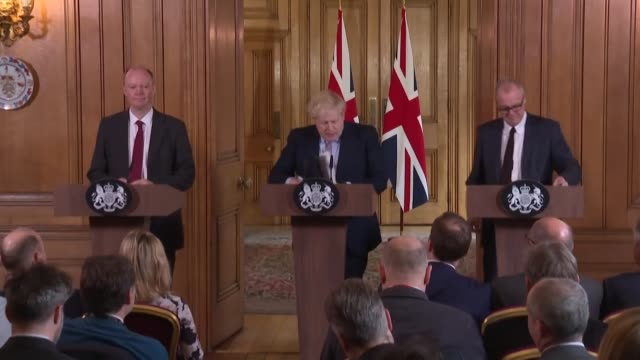 prime minister boris johnson flanked by the chief medical officer and chief scientific adviser holds a press conference on the publication of the... - publication stock videos & royalty-free footage