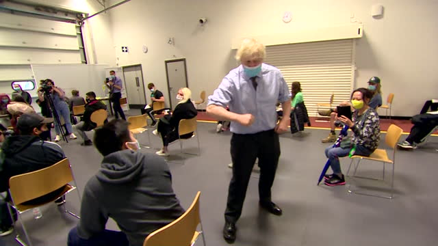 prime minister boris johnson greeting people with an elbow bump at a coronavirus vaccination centre - greeting stock videos & royalty-free footage