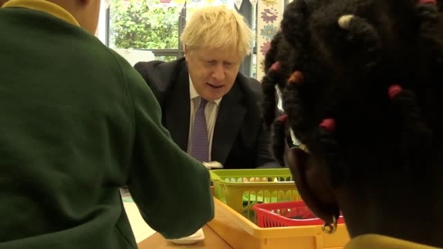 prime minister boris johnson interacts with kids as he visits middleton primary school in milton keynes. the prime minister said on thursday he would... - mp stock videos & royalty-free footage