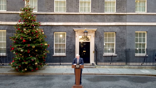 prime minister boris johnson makes a statement in downing street after receiving permission to form the next government during an audience with queen... - boris johnson stock videos & royalty-free footage