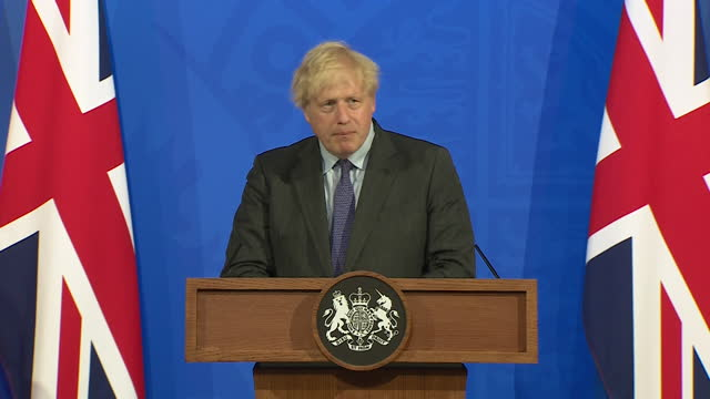 """prime minister boris johnson saying """"at a certain stage we are going to have to learn to live with coronavirus"""" - virus organism stock videos & royalty-free footage"""