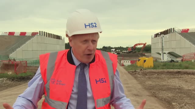 "prime minister boris johnson saying hs2 ""is crucial to this country"" and that it ""will deliver 22,000 jobs"" - helmet stock videos & royalty-free footage"