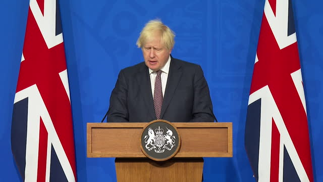 prime minister boris johnson saying the government will follow data and be cautious when going ahead with the lifting of coronavirus restrictions on... - following stock videos & royalty-free footage