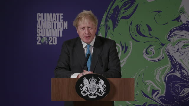 "prime minister boris johnson saying ""we're doing this not because we're hair-shirt wearing, tree-hugging, mung bean-munching eco-freaks"" at the... - tree hugging stock videos & royalty-free footage"
