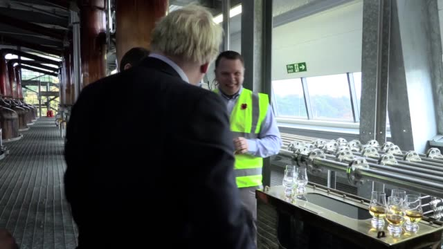 prime minister boris johnson tastes whiskey at the roseisle distillery in scotland near moray with ewan andrew from diagio and douglas ross, at the... - scotch whiskey stock videos & royalty-free footage