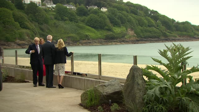 prime minister boris johnson, us president joe biden, with their wives carrie symonds and first lady jill biden, look out to sea at carbis bay,... - waterfront stock videos & royalty-free footage