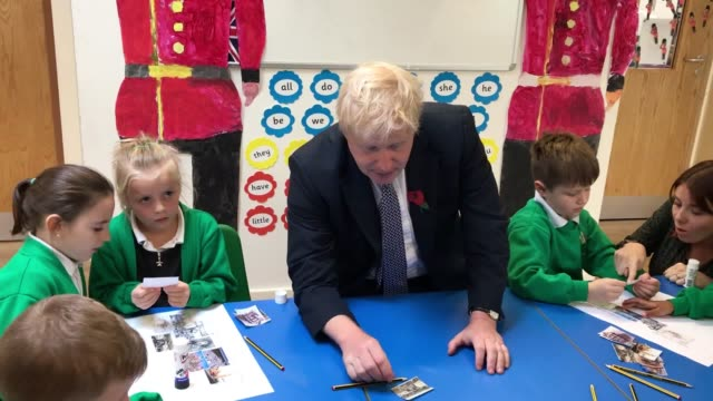 prime minister boris johnson visits abbots green academy primary school in bury st edmunds suffolk during the election campaign the tory leader got... - bury st edmunds stock videos & royalty-free footage