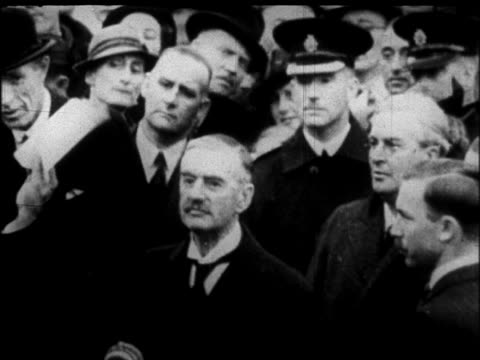 stockvideo's en b-roll-footage met prime minister chamberlain holding up paper to show crowd - 1938