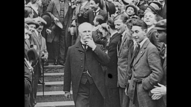prime minister david lloyd george walking down steps by cheering crowd / note exact month/day not known - 1910 stock videos and b-roll footage