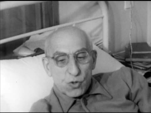 prime minister dr mohammad mosaddegh resting in bed w/ granddaughter massumeh next to him son golam hussain mosaddegh sitting fg ms mosaddegh sot... - granddaughter stock videos & royalty-free footage