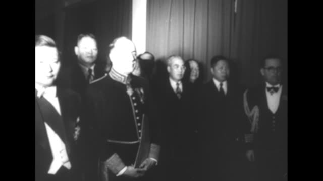 Prime Minister Giuseppe Pella in military uniform greets Chiang Kaishek / VS Italian and Chinese diplomats and officials at meeting / VS leaders...