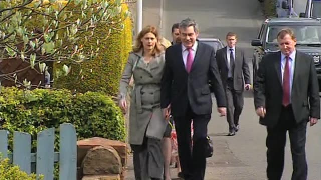 stockvideo's en b-roll-footage met prime minister gordon brown and wife sarah on their way to church on first weekend after the uk general election resulted in a hung parliament london... - number 9