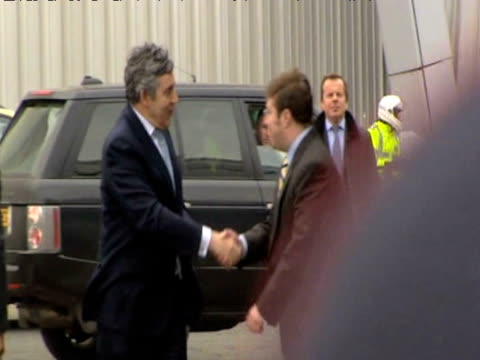 Prime Minister Gordon Brown arrives at Govan shipyard is heckled by rowdy crowd ahead of cabinet meeting in Glasgow 16 April 2009