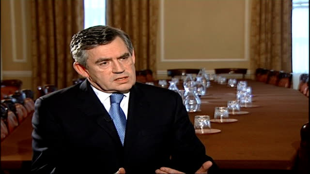 prime minister gordon brown interview; gordon brown along into room as shaking hands with brady prime minister gordon brown interview sot - the basic... - domande al primo ministro video stock e b–roll