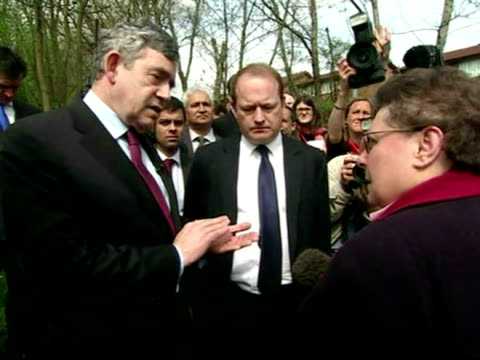 prime minister gordon brown meets gillain duffy whilst on the campaign trail in rochdale after the conversation in which mrs duffy asks mr brown... - ゴードン ブラウン点の映像素材/bロール