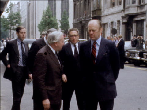 prime minister harold wilson shakes hands with president gerald ford and us secretary henry kissinger at nato summit brussels 30 may 75 - harold wilson stock-videos und b-roll-filmmaterial