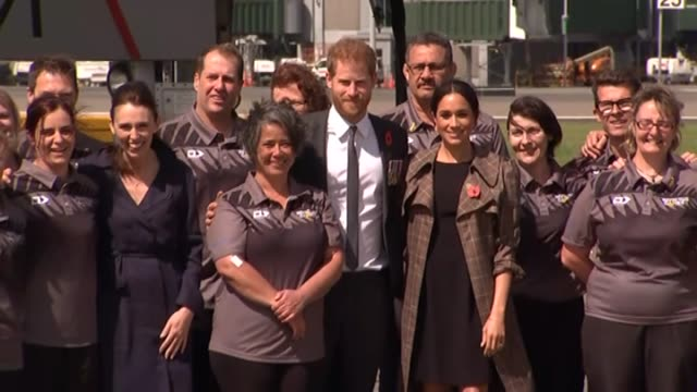 Prime Minister Jacinda Ardern and Prince Harry and Meghan the Duke and Duchess of Sussex pose for photograph with New Zealand Invictus Games team on...