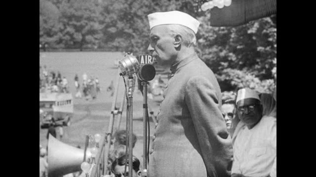 prime minister jawaharlal nehru reviewing indian troops in valley talking behind standing microphone 'british trained' indian soldiers firing... - anno 1947 video stock e b–roll