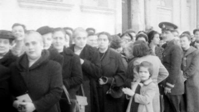 vidéos et rushes de prime minister konstantinos g karamanlis smiling and talking before heading in to vote / men huddled around ballot box / line of female voters... - 1956