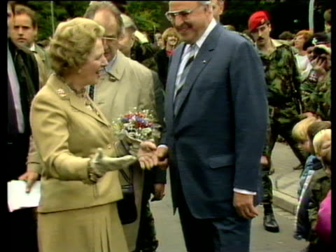 prime minister margaret thatcher and chancellor helmut kohl greet children in crowd on walkabout fallingbostel 17 sep 86 - chancellor stock videos & royalty-free footage