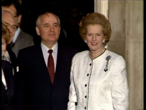 Prime Minister Margaret Thatcher and President Mikhail Gorbachev pose outside 10 Downing Street with Gorbachev's wife Raisa London 06 Apr 89