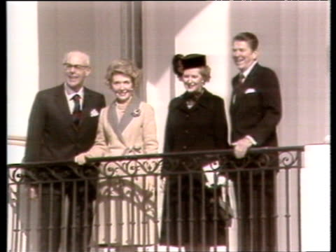stockvideo's en b-roll-footage met prime minister margaret thatcher and president ronald reagan stand on balcony of white house with dennis and nancy washington dc 26 feb 81 - 1981