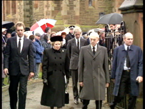 prime minister margaret thatcher and us ambassador to the uk charles h price walk from dryfesdale parish church following memorial service lockerbie... - lockerbie stock videos & royalty-free footage
