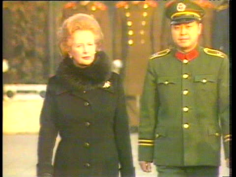 prime minister margaret thatcher inspects troops during visit to beijing for signing of sinobritish joint declaration agreeing handover of hong kong... - 1984 stock-videos und b-roll-filmmaterial