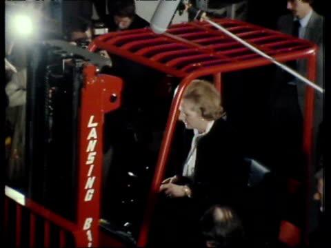 Prime Minister Margaret Thatcher manoeuvres fork lift truck on visit to factory UK 18 Apr 80