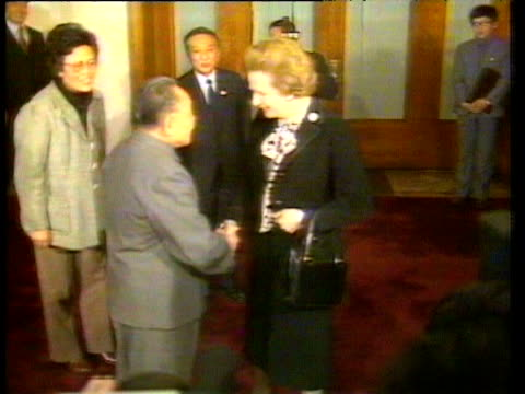 Prime Minister Margaret Thatcher shakes hands with Chairman Deng Xiaoping at signing ceremony of SinoBritish Declaration agreeing handover of Hong...